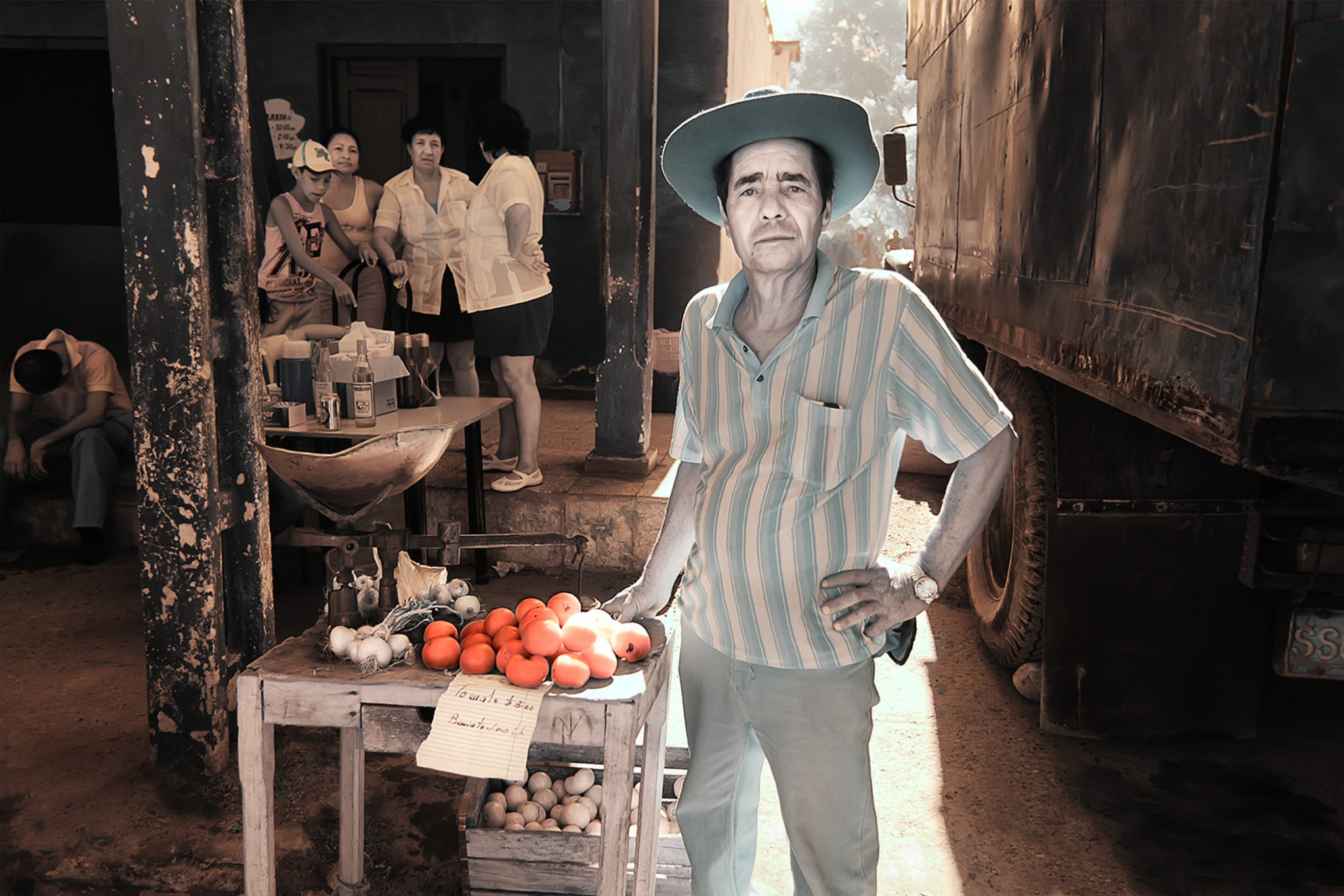 Man Selling Tomato 2/15 © EK Waller