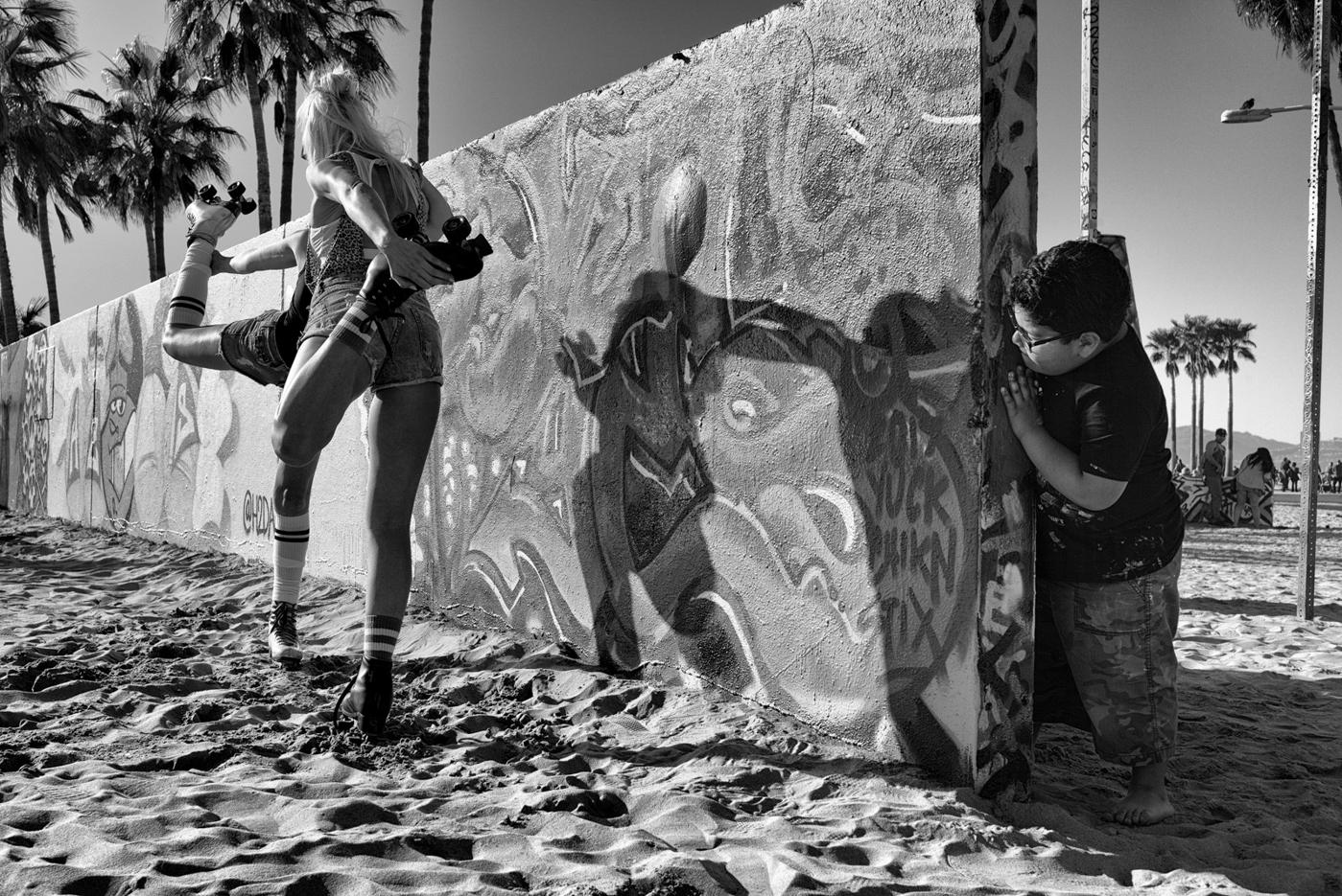 Peeking from Behind the Graffiti Wall © Dotan Saguy